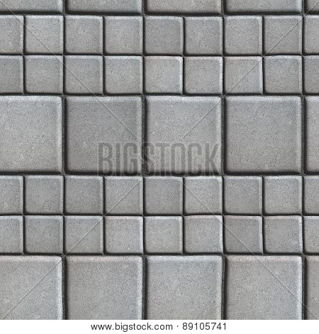 Gray Paving Slabs Lined with Squares of Different Value.