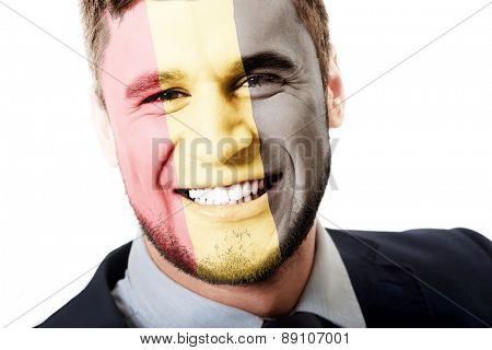 Happy man with Belgium flag painted on face.