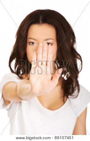 African teen woman making stop gesture.