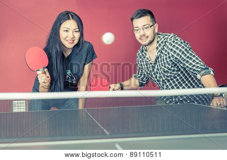 Couple Playing Ping Pong In A Bar