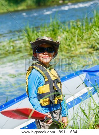 Boy kayaking on the river