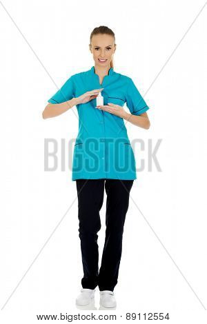 Nurse in uniform holding hydrogen peroxide.