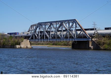 Bridge with Two Trains Crossing Over a River