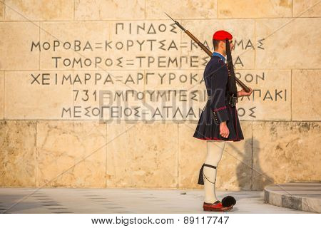ATHENS, GREECE - APR 14, 2015: Evzone guarding the Tomb of the Unknown Soldier in Athens dressed in service uniform, refers to the members of the Presidential Guard, an elite ceremonial unit.