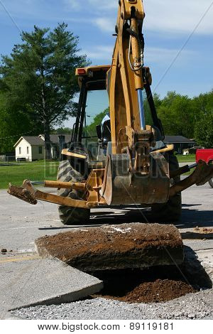 Backhoe Doing Roadwork