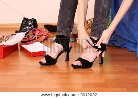 Young Woman Trying On New Shoes In A Store