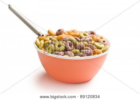 colorful cereal rings in bowl on white background