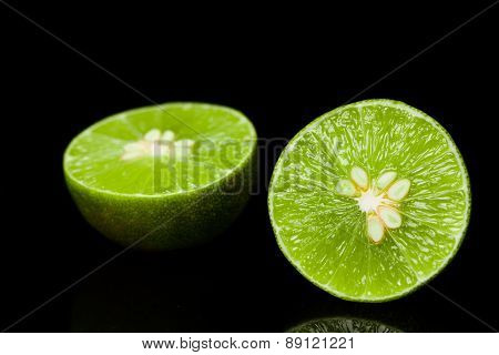 Abstract Dark Background With Citrus-fruit Of Lime Slices.