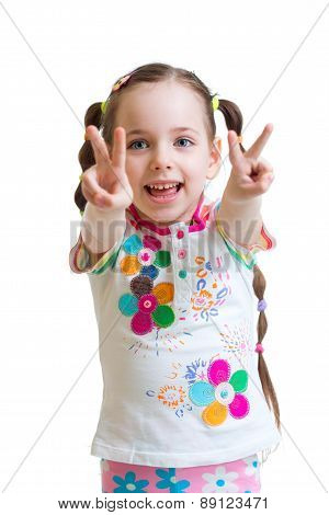 Child girl showing victory hand sign on white background