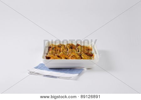 baked chicken wings in the porcelain tray