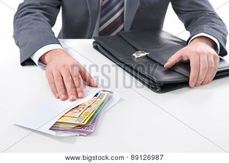 Concept - corruption. Businessman in a suit takes a bribe