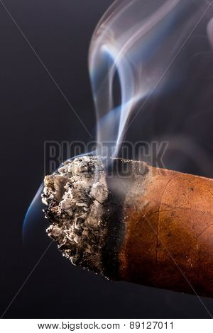smoking cigar. a symbol photo for addiction and related