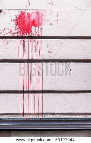 red ink splashes on a wall, icon red, criminal damage, vandalism