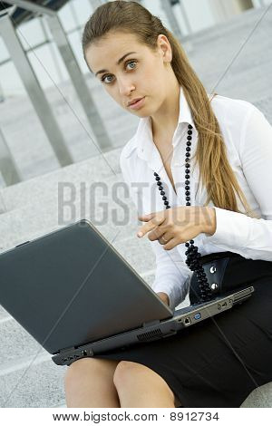 Business woman with laptop