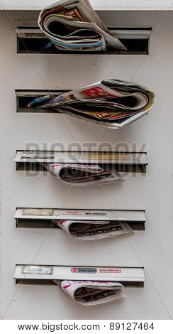 brochures in mailboxes, symbol for advertising, mail, marketing