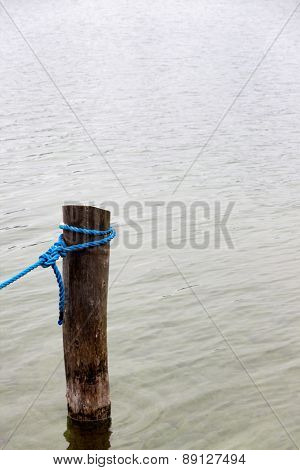 dew on a wooden pole, symbol of reliability, security, nautical, harbor