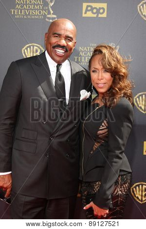 LOS ANGELES - APR 26:  Steve Harvey, wife at the 2015 Daytime Emmy Awards at the Warner Brothers Studio Lot on April 26, 2015 in Burbank, CA