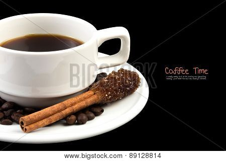 Cup of coffee with brown sugar on cinnamon stick