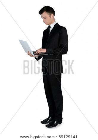 Isolated business man using laptop