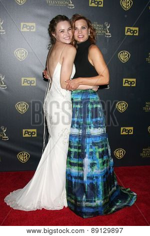 LOS ANGELES - APR 26:  Hunter King, Gina Tognoni at the 2015 Daytime Emmy Awards at the Warner Brothers Studio Lot on April 26, 2015 in Los Angeles, CA