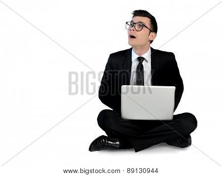 Isolated business man surprised with laptop