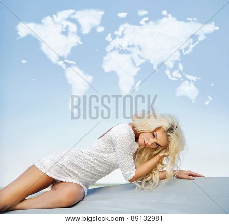 Cloud map and fashionable blonde beauty