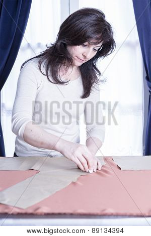 Seamstress Marking A Fabric.