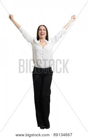 full length portrait of happy woman in formal wear raising her hands up and laughing. isolated on white background