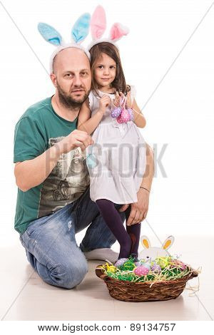 Father And Daughter Holding Easter Eggs