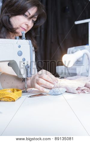 Seamstress Pinning The Fabric.