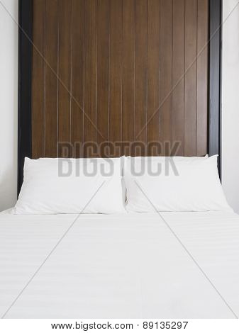 Bed mattress and pillows in bedroom