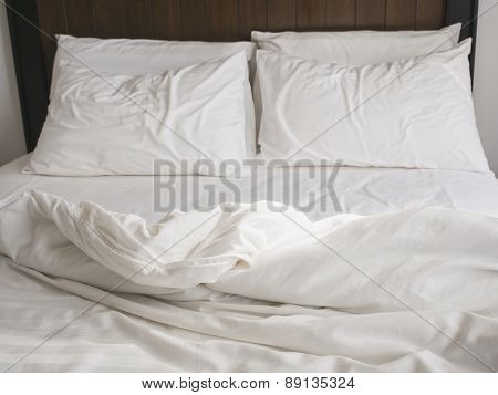 Bed Sheet Mattress and Pillows messed up in Bedroom