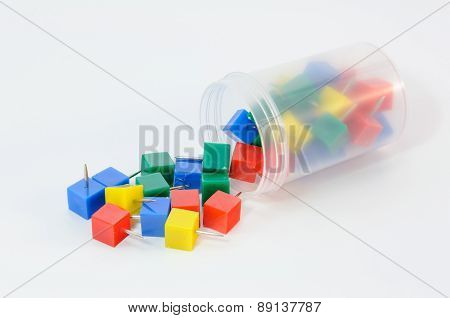 Multi Color Pushpins On White Background