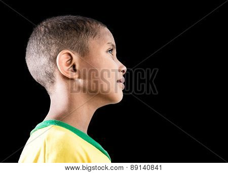 Brazilian little boy isolated on black background