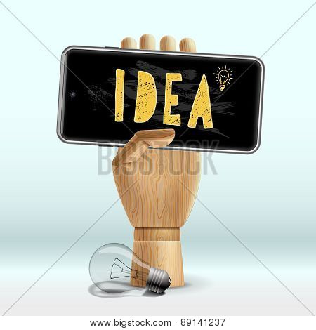 Idea concept. Wooden human hand with mobile phone