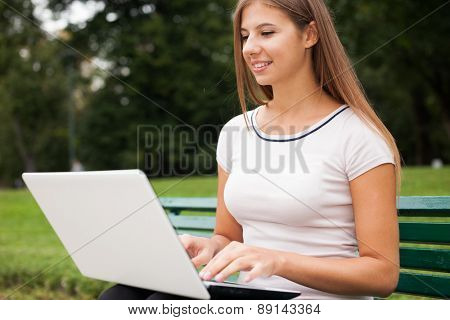 Young woman using a laptop computer outdoors