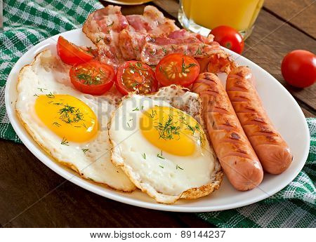 English breakfast - egg, bacon and vegetables in a rustic style on wooden background