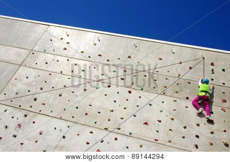 Youngster's effort in climbing a wall to reach the top