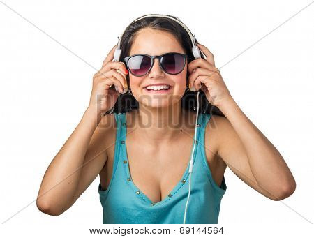 Happy young woman listening to music with white headphones