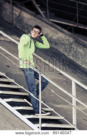 Teen boy in depression standing on the steps