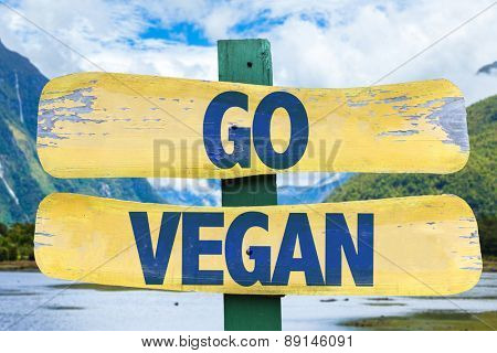 Go Vegan sign with mountains background
