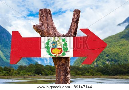 Peru Flag wooden sign with countryside background