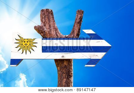 Uruguay Flag wooden sign with sky background