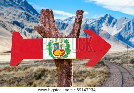 Peru wooden sign with mountains on background