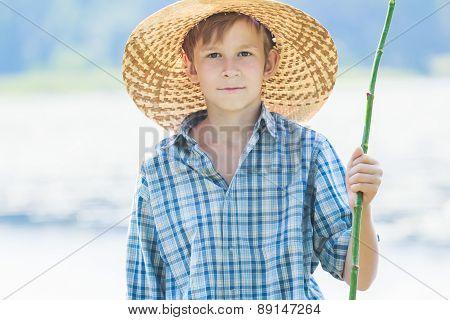 Teenage Fisherman With Handmade Green Twig Fishing Rod
