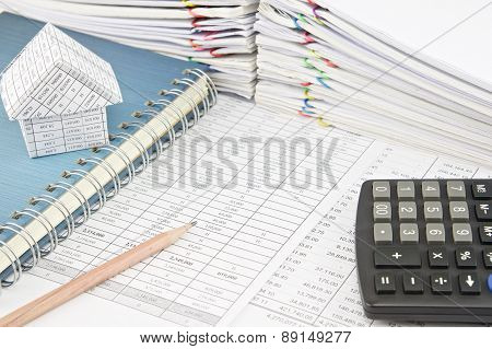 Pencil And House On Notebook With Calculator