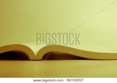 Opened Book Against Blank Background