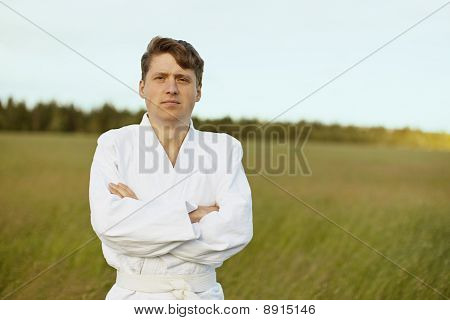 Man In White Kimono Against Evening Nature
