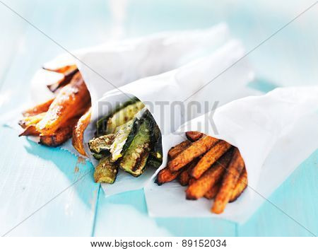trio of carrot, zucchini, and sweet potato fries wrapped up in wax paper cones