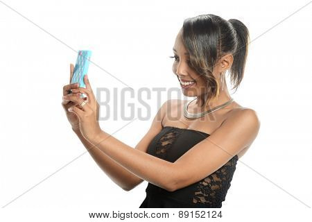 Young black woman taking a selfie isolated on a white background